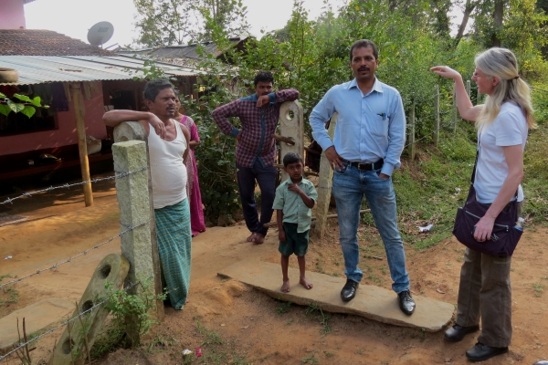 Taluk Health Officer Dr Kiran and social scientist Dr Gill Ainsworth talk to villagers about how the risk of KFD affects the way they use the forest - photo by Sarah Burthe